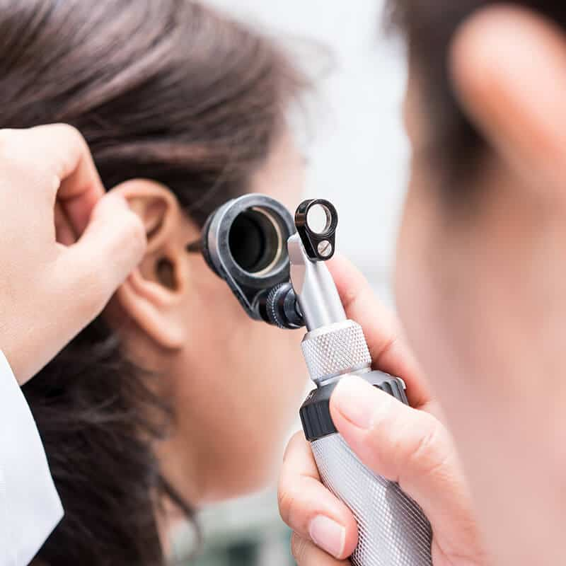 examining the ear with an otoscope